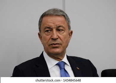 Brussels, Belgium. 26th June 2019. Turkey's Minister of National Defence, Hulusi Akar meets Minister of National Defence of Greece Evangelos Apostolakis within NATO Defense Ministers' meeting.