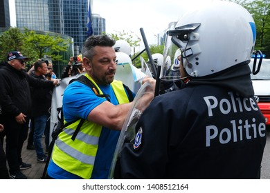 Brussels, Belgium. 26th May 2019. Demonstrators clash with police as they intervene in a demonstration by yellow vests at Brussels-North railway station.