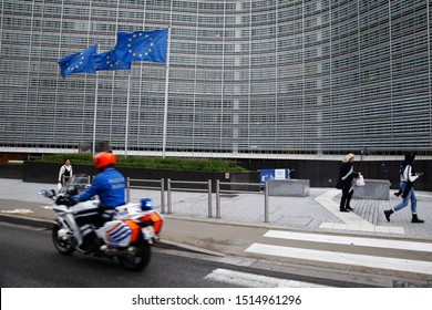 Brussels, Belgium. 26th September 2019. A policeman passes with his motorcycle outside of the EU headquarters.