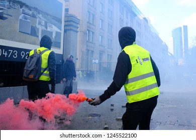 Brussels, Belgium. 30th November 2018. Riot Police uses a water canon against demonstrators during  a protest against the rising of the fuel and oil prices by people wearing yellow vests.