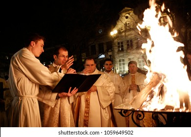 Brussels, Belgium. 31st March 2018. Priests bless the Holy Fire during an Easter vigil mass in St. Catherine's Church .