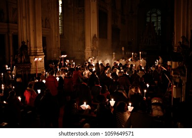 Brussels, Belgium. 31st March 2018. Worshipers hold candles during an Easter vigil mass in St. Catherine's Church .