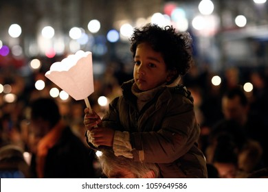 Brussels, Belgium. 31st March 2018. A kid holds a candle during an Easter vigil mass in St. Catherine's Church .