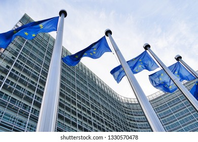 BRUSSELS, BELGIUM -6 FEB 2019- European Union (EU) flags in front of the Berlaymont building, headquarters of the European Commission in Brussels.