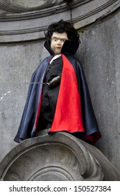 BRUSSELS, BELGIUM - 6TH APRIL 2013: The famous Manneken Pis in Brussels - dressed as a Vampire.