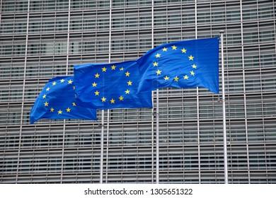 Brussels, Belgium. 6th Feb. 2019. European flags flap in the wind outside EU headquarters.