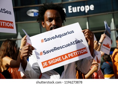 Brussels, Belgium. 6th October 2018. People gather to stage a protest after Aquarius migrant rescue ship's flag revoked following alleged pressure from the Italian government