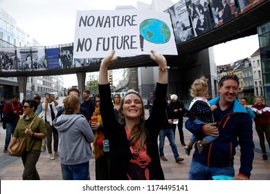 Brussels, Belgium. 8th Sep. 2018.Activists hold placards and chant slogans during a demonstration to demand immediate an action on climate change in front of European Parliament.