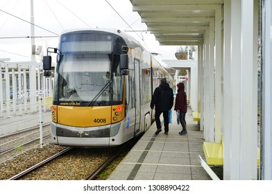 BRUSSELS, BELGIUM -9 FEB 2019- View of a STIB tram on rail tracks at the Heysel (Heizel) train and metro station near the Atomium located in Brussels, Belgium.