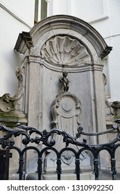 BRUSSELS, BELGIUM -9 FEB 2019- View of the landmark Manneken Pis statue of a small boy peeing in a fountain in downtown Brussels, Belgium. It has become a symbol of the city.