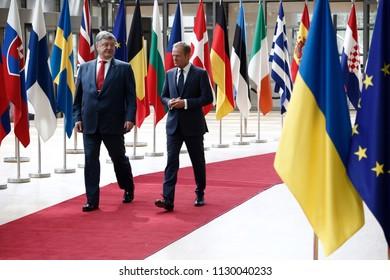 Brussels, Belgium. 9th July 2018. European Council President Donald Tusk walks with Ukrainian President Petro Poroshenko ahead of a meeting .