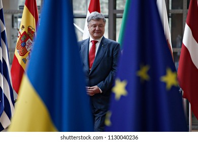Brussels, Belgium. 9th July 2018. European Council President Donald Tusk walks with Ukrainian President Petro Poroshenko ahead of a meeting .