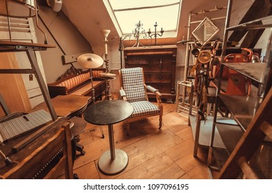 BRUSSELS, BELGIUM - APR 2: Attic of antique store with vintage armchair, decoration, wooden furniture, retro details on April 2, 2018. More than 1,200,000 people lives in Brussels