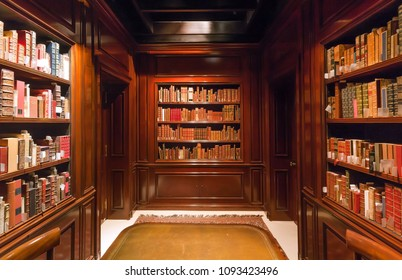 BRUSSELS, BELGIUM - APR 2: Bookshelves with old volumes of books and antiquewooden table inside the Royal Library on April 2, 2018. More than 1,200,000 people lives in Brussels