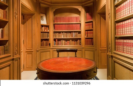 BRUSSELS, BELGIUM - APR 2: Bookshelves with old volumes of books and antique round table inside the Royal Library on April 2, 2018. More than 1,200,000 people lives in Brussels