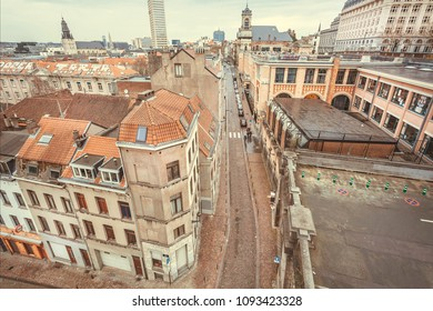 BRUSSELS, BELGIUM - APR 2: Cityscape with historical narrow streets and old tile houses with roofs on April 2, 2018. More than 1,200,000 people lives in Brussels