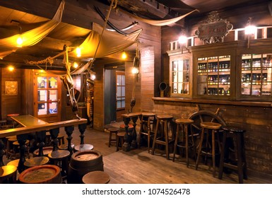 BRUSSELS, BELGIUM - APR 2: Interior of old schooner style bar with old wooden furniture, pirate themes decor, pub counter and barrels on April 2, 2018. More than 1,200,000 people lives in Brussels