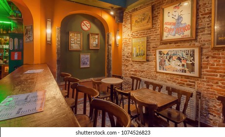 BRUSSELS, BELGIUM - APR 2: Interior of brick walls bar with old posters, retro furniture, pub counter and menu of drinks on April 2, 2018. More than 1,200,000 people lives in Brussels