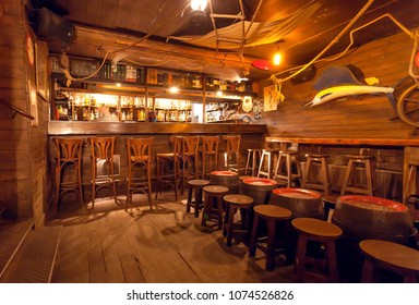 BRUSSELS, BELGIUM - APR 2: Interior of retro style bar with old wooden furniture, pirate themes decor, pub counter and barrels on April 2, 2018. More than 1,200,000 people lives in Brussels