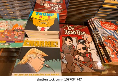 BRUSSELS, BELGIUM - APR 2: Magazines and comics with funny books about USA president Trump and Hitler in Museum of Comic and Cartoon Art on April 2, 2018. More than 1,200,000 people lives in Brussels