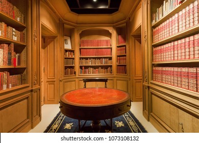 BRUSSELS, BELGIUM - APR 2: Many bookshelves with old volumes of books and antique round table inside the Royal Library on April 2, 2018. More than 1,200,000 people lives in Brussels