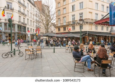 BRUSSELS, BELGIUM - APR 2: Many people inside the old elegant retro cafe or bar with mirrors drinking beer and having dinner on April 2, 2018. More than 1,200,000 people lives in Brussels
