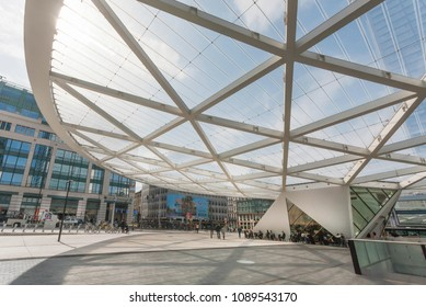 BRUSSELS, BELGIUM - APR 2: Urban view on city with modern buildings and people outside the cafe or bar drinking and talking on April 2, 2018. More than 1,200,000 people lives in Brussels