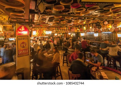 BRUSSELS, BELGIUM - APR 2: Women and men drinking alcohol inside the old bar Delirium with retro furniture and huge beer menu on April 2, 2018. More than 1,200,000 people lives in Brussels