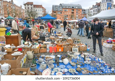 BRUSSELS, BELGIUM - APR 3: Customers of flea market and many old art, bargains and antique stuff in mess of vintage decor and retro details on April 3 2018. More than 1200,000 people lives in Brussels