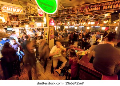 BRUSSELS, BELGIUM - APR 3: Funny evening inside beer bar with crowd of friendly people, old retro furniture on April 3, 2018. More than 1,200,000 people lives in Brussels
