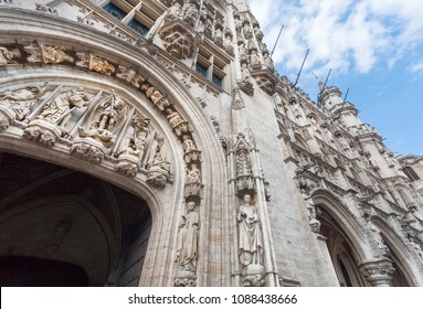 BRUSSELS, BELGIUM - APR 3: Old arch with Gothic sculptures and allegorical figures of 15th century Town Hall, UNESCO world heritage on April 3, 2018. More than 1,200,000 people lives in Brussels