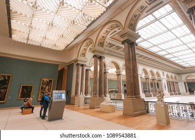 BRUSSELS, BELGIUM - APR 3: People watching information about art inside Royal Museums of Fine Arts, established in 1803, on April 3 2018. Museum contains 20,000 drawings of Bruegel, Flemish painters