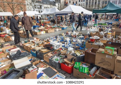 BRUSSELS, BELGIUM - APR 3: Traders of flea market and many old art, bargains and antique stuff in mess of vintage decor and retro details on April 3 2018. More than 1,200,000 people lives in Brussels