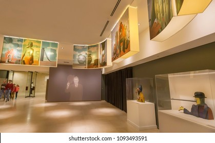 BRUSSELS, BELGIUM - APR 3: Visitors inside hall of Rene Magritte Museum with 200 original paintings, artworks, sculptures on April 3 2018. Opened in 2009, museum dedicated to Belgian surrealist artist