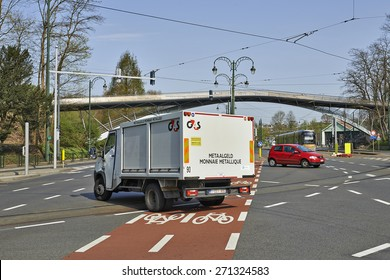 BRUSSELS, BELGIUM - APRIL 16, 2015: A security truck from G4S passes through the intersection on the Avenue de Tervuren in Brussels, Belgium