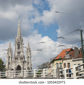 Brussels, Belgium - April 17 : A man walks in front of Church of Our Lady of Laeken near the atomium in Brussels, Belgium, Europe on April 17, 2017