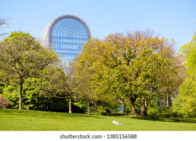 Brussels, Belgium - April 19, 2019: The Paul-Henri Spaak building, sticking out above the trees of the Leopold park, houses the hemicycle, the debating chamber of the European Parliament since 1994.