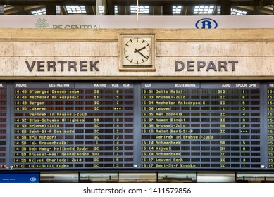Brussels, Belgium - April 20, 2019: The arrivals and departures board in Brussels central station displays the names of the cities alternately in french and dutch, the two main official languages.