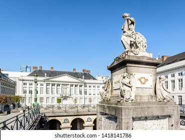Brussels, Belgium - April 20, 2019: The Martyrs' square is home to the Memorial to the martyrs of the 1830 revolution and neo-classical buildings like the Flemish minister-president's cabinet office.