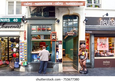 Brussels, Belgium - April 2015: Le Funambule, famous homemade waffle shop located at Grand Place next to Manneken Pis landmark in Brussels, Belgium