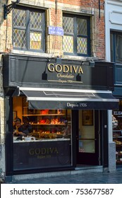 Brussels, Belgium - April 2015: Outlet of Godiva, a manufacturer of premium fine Belgian chocolates, truffles, and holiday gifts, at Manneken Pis branch in Brussels, Belgium