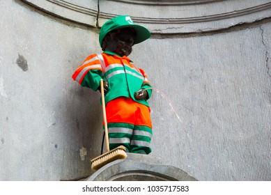 Brussels, Belgium - April 22, 2017: Manneken Pis - Little man Pee or le Petit Julien, a landmark small bronze sculpture in Brussels, Belgium