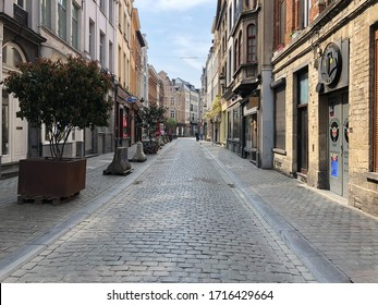 Brussels / Belgium - April 24 2020: Surrealistic empty streets with closed shops, bars and restaurants in Brussels, Belgium during the Covid-19 pandemic and lockdown.