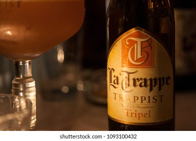 BRUSSELS, BELGIUM - APRIL 28, 2018: Bier Bottle of La Trappe Tripel. It is a Dutch Trappist beer from the abbey of De Koningshoeven Brewery, produced in Berket Enschot