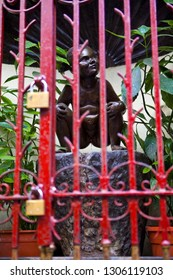 Brussels, Belgium - April 2nd 2013: A view through the railings of Jeanneke Pis - the female version of the historic Manneken Pis fountain, in Brussels, Belgium.