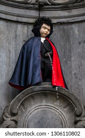 Brussels, Belgium - April 6th 2013: A view of the historic Manneken Pis sculpture, dressed up as a Vampire, in the city of Brussels in Belgium.