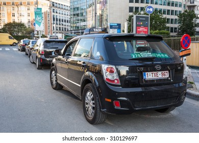 BRUSSELS, BELGIUM - AUG 21: Taxis Vert - electric and hybrid taxis waiting for customers in the city street of Brussels. August 21, 2015 in Brussels, Belgium