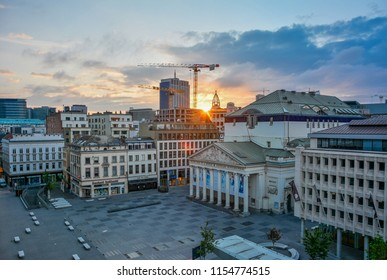 Brussels / Belgium — August 15, 2015: panorama of Place de la Monnaie in Brussels at sunrise in the early morning, with the Theatre Royal de la Monnaie (or de Munt), a major national opera house