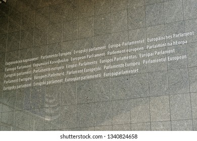 BRUSSELS, BELGIUM - AUGUST 16, 2018: European parliament written in all the languages from the European Union, on the front wall of the main building.