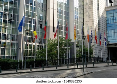 BRUSSELS, BELGIUM - AUGUST 16, 2018: Waiving flags in front of the European Parliament building in Brussels.